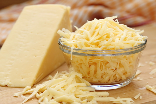 grated cheese in glass bowl